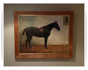 Margaret Collyer, dark bay horse in a stable
