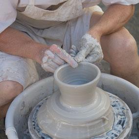 Man at potters wheel by VisualsSpeak