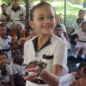 Girl with tarantula. Wildlife conservation through education.