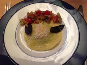 Raviolo mit flüssigem Eigelb und Tomaten-Fenchel-Concassée