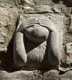 See no evil monkey stone carving