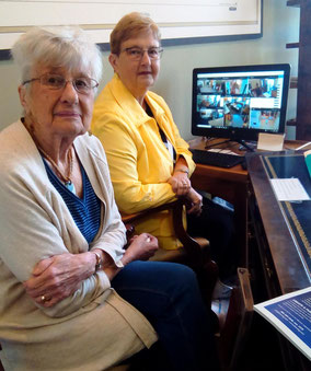 Docents Donna Kiel and Judy Stoel are able to observe visitors from a single monitor