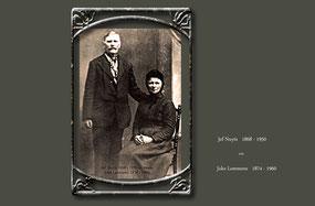 Oude studiofoto met een man staande naast zijn vrouw die op een stoel zit. Ongeveer 1900.