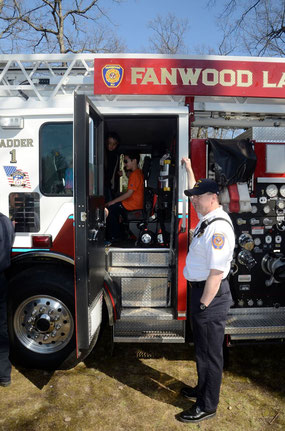 Assistant Chief Steve Szanto gives a tour of Ladder 1 at the Rockin' for Autism event