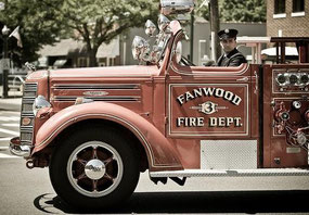 FF Drewes driving Engine 3, our antique 1947 Mack Type 45 pumper, in a Labor Day Parade.