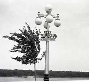"In the 1920s, a sign was placed at the lights on the top of the stairway, directing visitors to Bellevue State Park, ""The World's Scenic Spot."""
