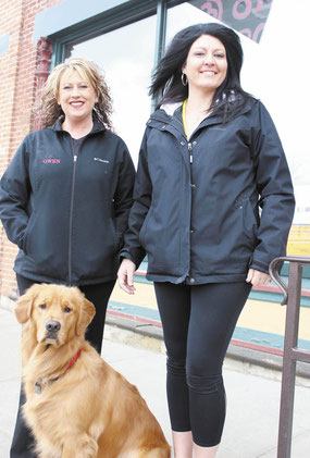 Gwen Damisch, owner of Gwen's Pet Grooming (left) with her dog Gibbs, is pictured with the new Bellevue location manager, Carli (Roling) LaCoursiere.