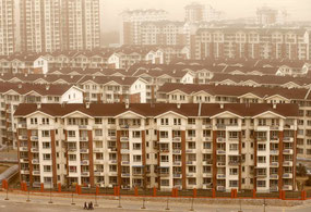 New apartment buildings for former miners and farmers in a suburb of Beijing. Credit Kim Kyung-Hoon/Reuters