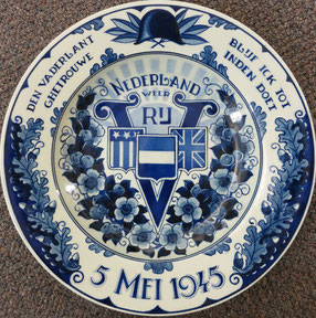 "This hand painted commemorative plate was presented to the museum in 2006 to honor the liberation of the Netherlands after World War II. The mark on the back reads ""Maastricht"""