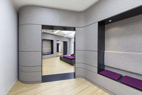 Moderner Innenausbau Arztpraxis mit ausgefallenen Materielien wie Fliz, Stahlblech, Mineralwerkstoff