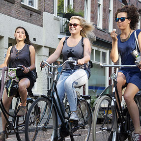 Ladies cycling on a bike tour in Amsterdam