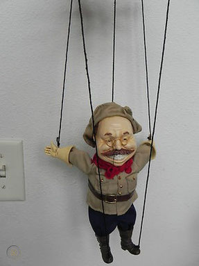 Puppet Lukashenko hanging on Putin's strings