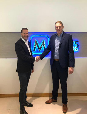 Yuval Baruch (left) of Hermes Logistics and Menzies' Mark Reid are pleased with the conclusion of the contract  -  company courtesy