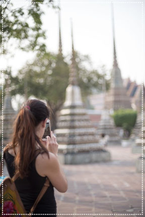 Irene taking pictures with her phone in Bangkok