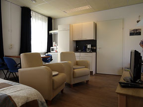 The room has 2 comfortable seating areas and also a kitchen unit