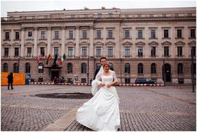 Bride and groom pose in front of Hotel de Rome in Berlin