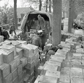 Transfer of the Food supplies at the Nude. (Canadian Archives)