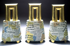 "a series of lidded boxes with the title ""end of the rainbow"" dealing with the Nazi gold story"