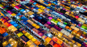 Night market in bangkok from above with many different colors.