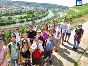 German Language Summer Course University of Würzburg, leisure activities, group photo international students at festival, beergarden