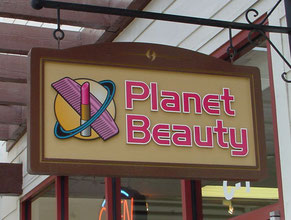 Planet Beauty Wood Sign