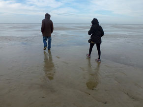 Anu and Lennart walking on the beach