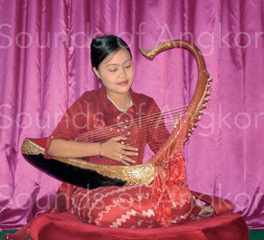 Burmese harpist playing on silk strings.