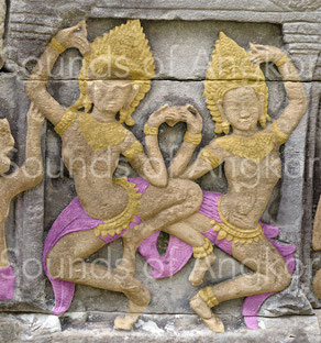 Female dancers with belt bells and toric ankle bracelets. Bayon.