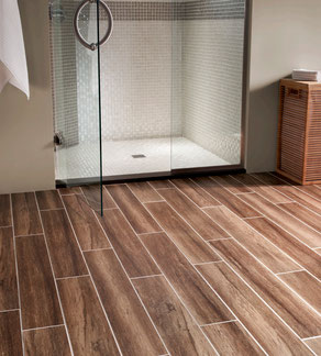 Earthy, natural-looking porcelain wood tiles on a bathroom floor