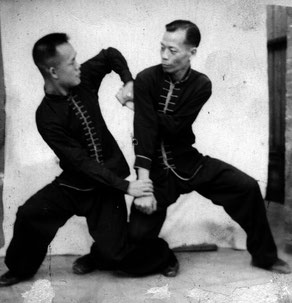 SIFU SHUM (LEFT) PRACTICING IN HONG KONG
