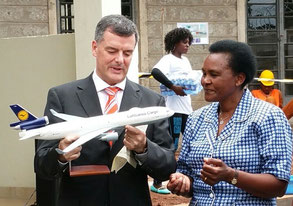 LH Cargo's Exect. Board member Martin Schmitt handed over a model MD-11F to Paula Karanja, Head of MMH