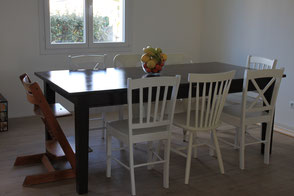 The dining room table set up with a Tripp Trapp high chair for a child
