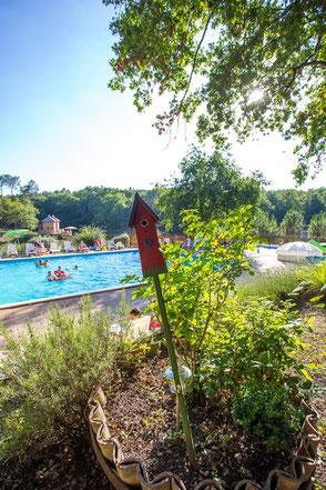Camping en dordogne avec piscine et etang de peche