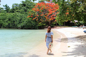 Woman walking along white sand beach - Tour to Negril
