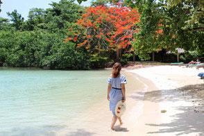 Woman walking along white sand beach - Tour to Negril