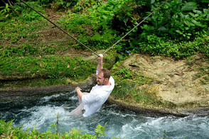 Man in the roaring river - Ocho Rios Excursions