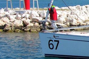 Ragattateilnehmer achten Meerschutz