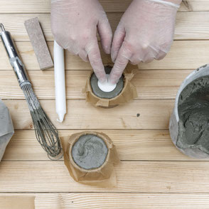 Setting candles in concrete as part of the DIY Concrete Candle Holder Tutorial, a wonderfully easy concrete diy with recycled moulds and baking paper to create a tree bark texture! #diy #concrete #tutorial #pasinga #blogging