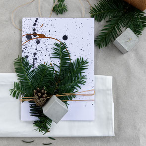 Recycled paper modern pocket journal wrapped with fir and concrete cube ornament for Christmas