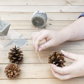 Wire the pine cones to the concrete base to let them float PASiNGA tutorial