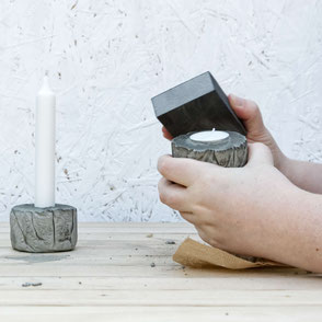 Sanding last set of the DIY Concrete Candle Holder Tutorial, a wonderfully easy concrete diy with recycled moulds and baking paper to create a tree bark texture! #diy #concrete #hygge #tutorial #pasinga #blogging