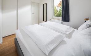 Strandloft 3 Norderney Wohnung 1 - Schlafzimmer Ansicht 2