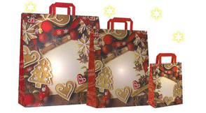 'Weihnachstüte mit Papiergriff in rot und Weihnachtmotiv mit Lebkuchen Tannenbaum Kugeln bedruckt