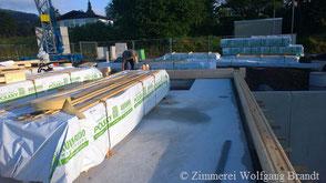 Baubericht - Ankunft der Lieferung auf der Baustelle in Deutschland - Montagebeginn des Hauses - Blockhaus bauen - Holzhaus bauen