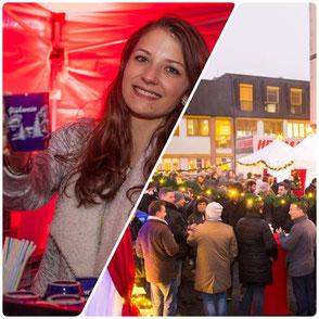Mitarbeiter schenken Glühwein aus, Lichterketten und Weihnachtsmarkt