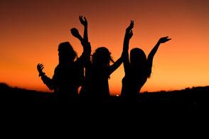 sunset celebration of 3 people