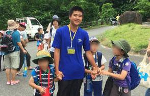 福島の子供たちのための保養施設、NPO法人沖縄球美の里でボランティアをする生徒。この活動をきっかけに保育士を目指すようになった生徒がいます。