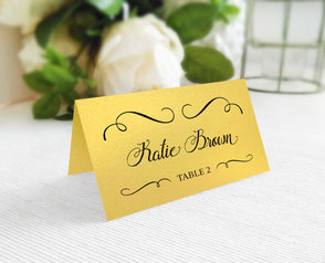 Gold shimmer wedding name cards