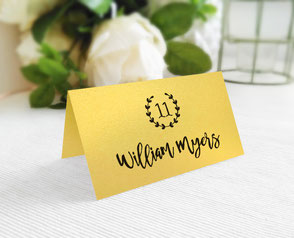 Wedding name cards printed on gold shimmer paper