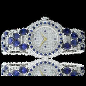 Handgearbeitete Armbanduhr in Weissgold mit Saphir und Brillanten. Hergestelt auf Kundenwunsch in unserem Goldschmiede Atelier OBSESSION Zürich und Wetzikon.